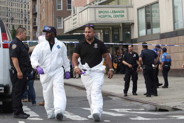 New York City police officers with the forensics unit leaving Bronx-Lebanon Hospital Center on Friday after a gunman killed one person and hurt six others before killing himself. Credit Mary Altaffer/Associated Press