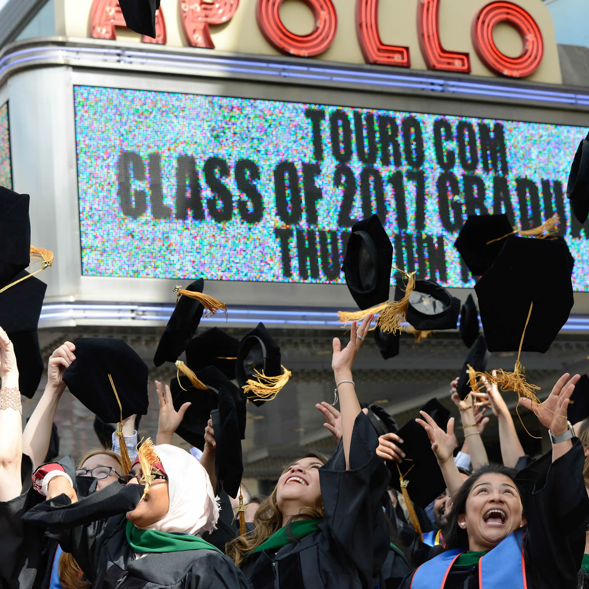 DO graduates toss their caps at the TouroCOM Harlem class of 2017 commencement.