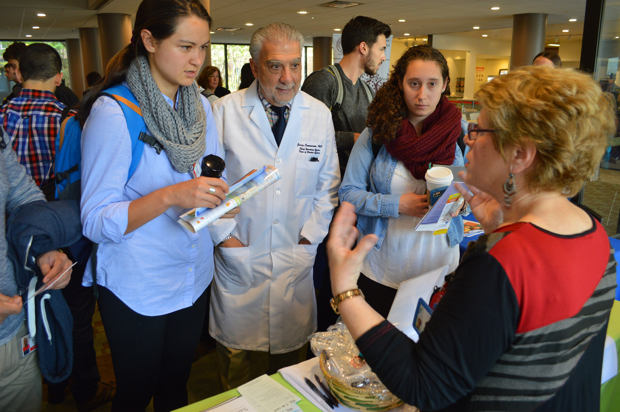 TouroCOM-Middletown D.O. student Andrea Attenasio, far left, speaks to an agency representative at the JMHCA Fair in October 2015.