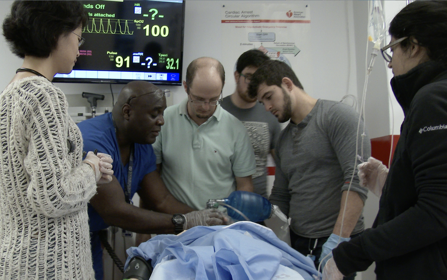 Dr. David Colbourne in the medsim lab with his students.