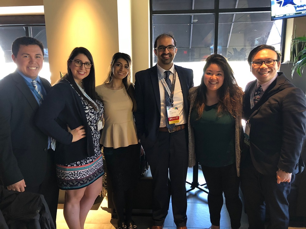 Dr. Sonu Sahni, center, together with his students. Dr. Sahni received the 2018 TouroCOM Harlem Frank Gray Teacher of the Year Award.