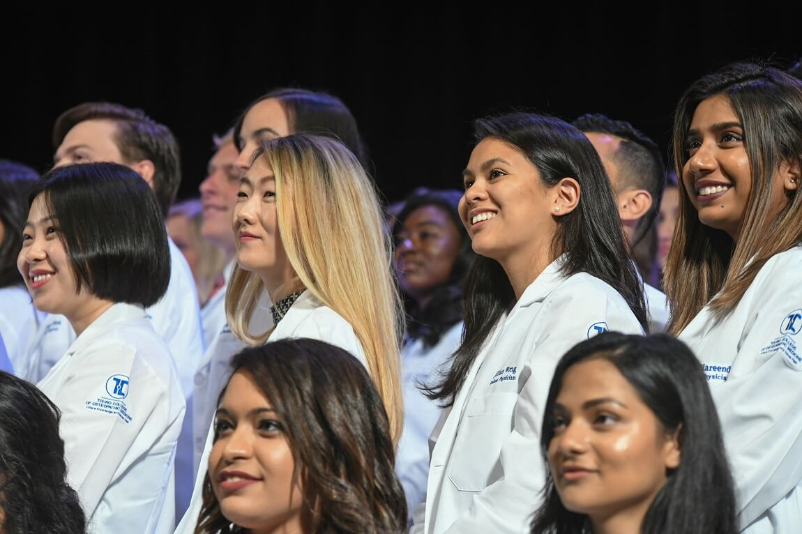 Members of TouroCOM Middletown's class of 2023 donned their white coats on July 22.