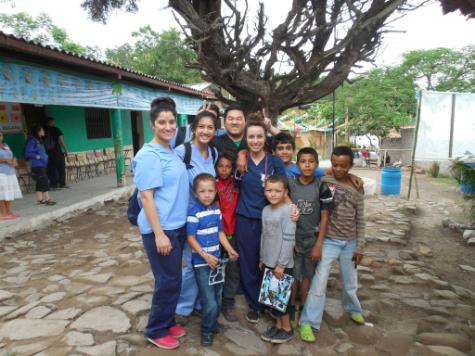 Students from TouroCom Middletown bond with Honduran children who received medical care.