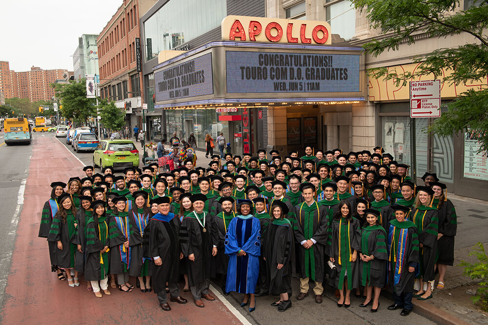 Class of 2019 assembled outside Apollo Theater for commencement.