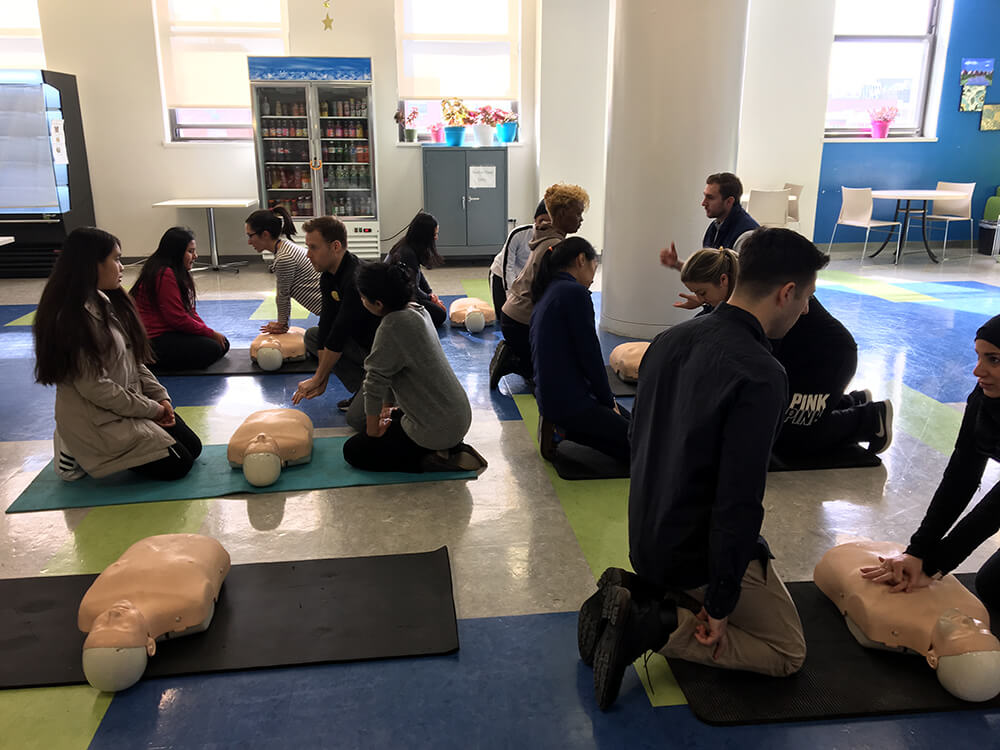 Students teaching Texas Two Step CPR Technique
